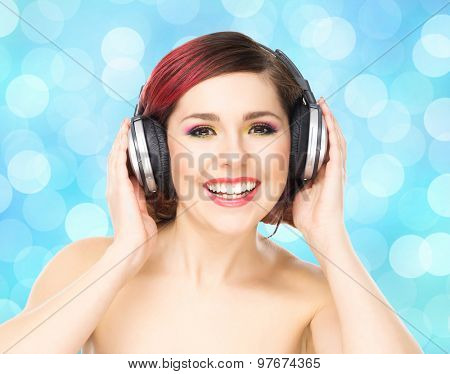 Beautiful girl listening to the music throughout headphones on bubble background.