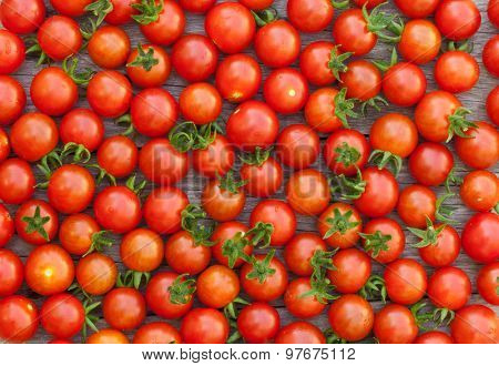 Ripe cherry tomatoes texture on wooden table