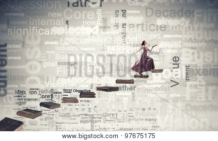 Woman in long dress with book in hand