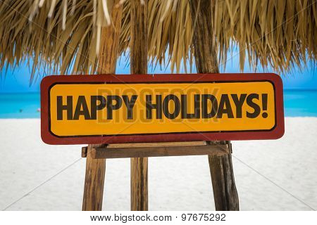 Happy Holidays sign with beach background