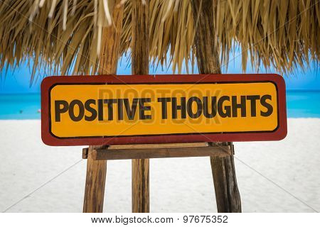 Positive Thoughts sign with beach background