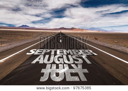 July August September written on a desert road