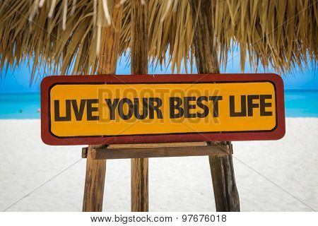 Live Your Best Life sign with beach background