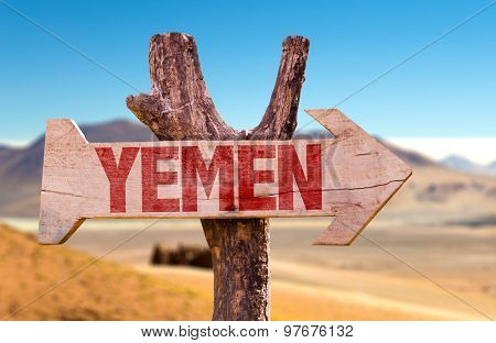 Yemen wooden sign with desert background