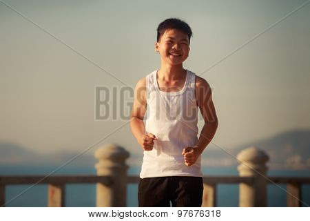 Vietnamese Boy Runs On Embankment At Dawn