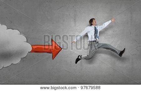 Young speedy businessman running in a hurry