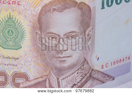 Close Up Of Thailand Currency, Thai Baht With The Images Of Thailand King. Denomination Of 1000 Baht