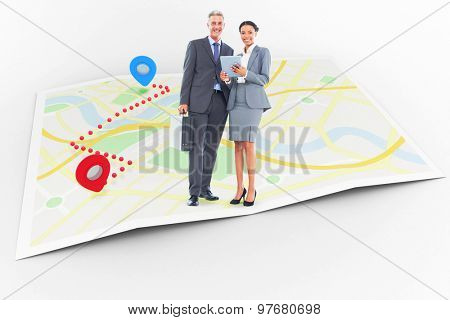 Business people using tablet computer against map showing a route