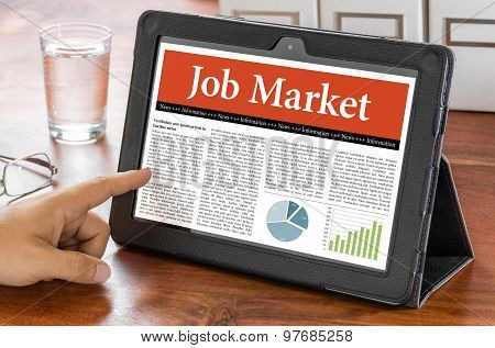 A Tablet Computer On A Desk - Job Market
