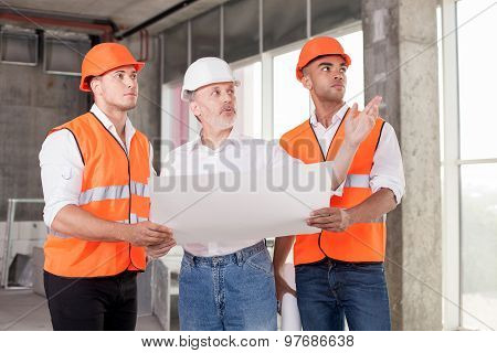 Successful skilled builders are discussing a new construction