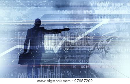 Back view of businessman and graphs at background
