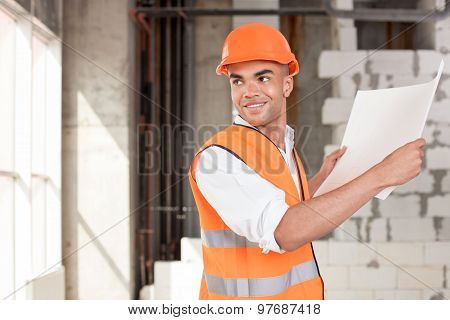 Attractive young architect is in process of building