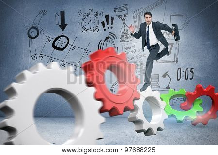 Stern businessman in a hurry against grey room