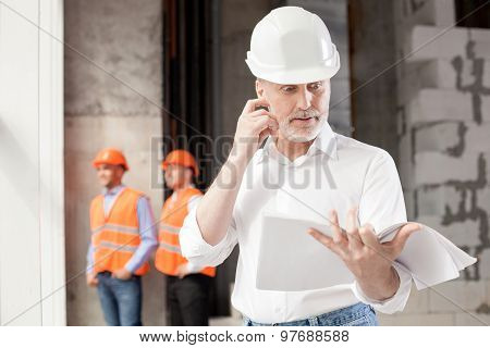 Cheerful engineers are planning to build new construction