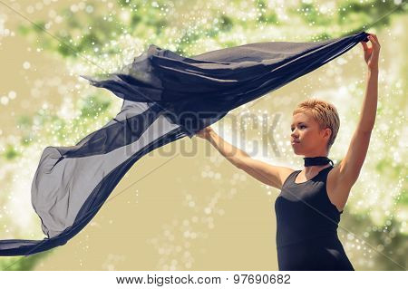Beautiful Young Woman In Black Evening Dress Holding Black Fabric At Wind