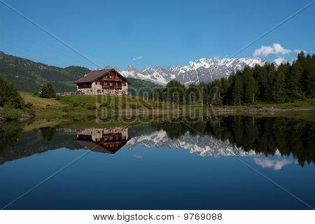 Mountain lake with house