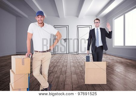 Happy delivery man leaning on trolley of boxes against doodle doors in room