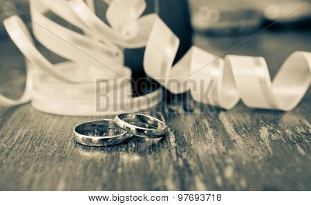 Wedding gold rings of the groom and the bride on a table