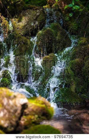 Mountain Creek Flowing Through Mossy Boulders