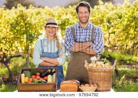 Portrait of a happy farmer couple with arms crossed