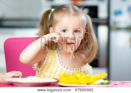 kid eating healthy food at home