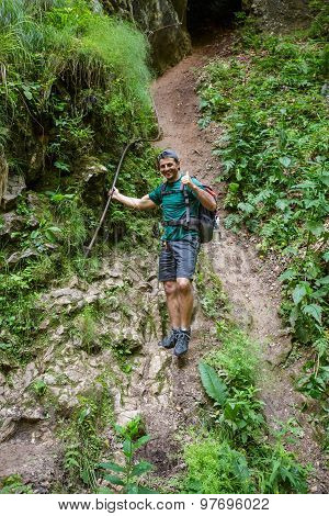 Man Hiker Holding On To A Safety Cable