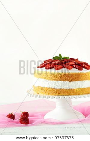 Sweet Cake With Strawberries On Cake Stand On White Wooden Background