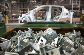 stock photo of assembly line  - Automotive industry manufacture line with different metal parts - JPG