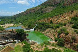 stock photo of crocodile  - Waterfall of Crocodile River Hartbeespoort Dam in South Africa - JPG