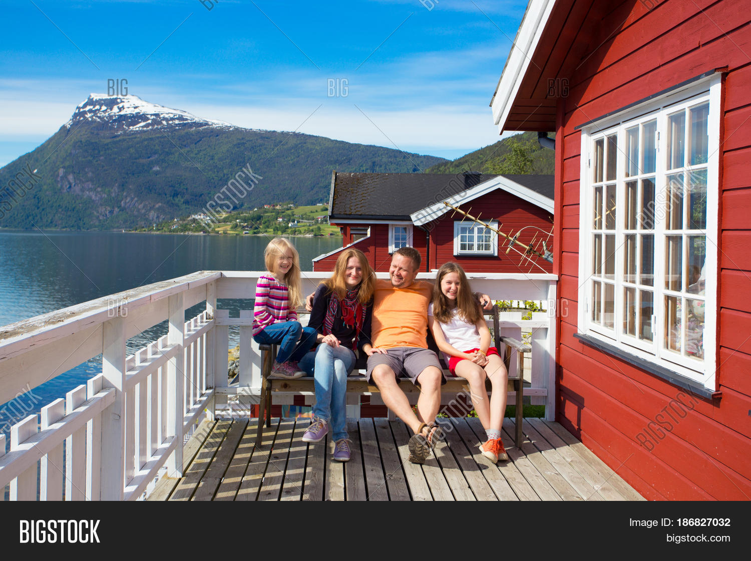 Happy family on wooden terrace image photo bigstock for Kids on the terrace