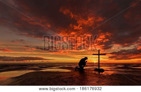 One man praying at a black cross on a beach with the tide out pools of water gives a wonderful texture reflection.