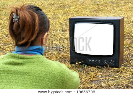 Girl watching TV in meadow. Element of design.