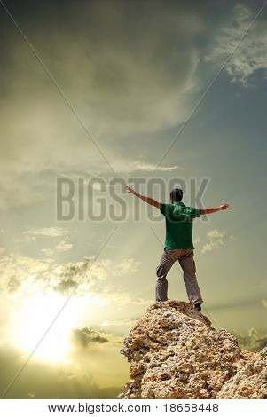 Man on peak of mountain. Conceptual design.