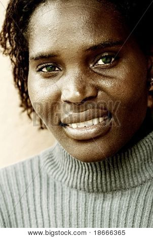 African young woman, wrinkles enhanced, white balance changed for the gold look