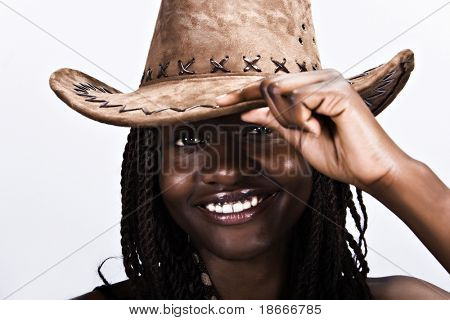 Young African woman smiling, with cowboy hat and dreadlocks hairstyle