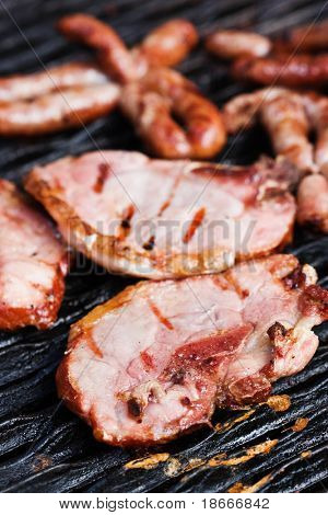 mixed barbecue stake and sausage , variety of meat