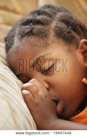 don't worry be happy, African child with braids sleeping on the couch