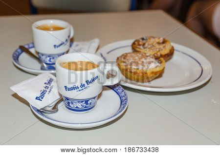 LISBON, PORTUGAL - APRIL 24: Coffee cups and pastry at the famous cafe Pasteis de Belem in Lisbon in Portugal on April 24, 2017