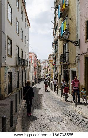 LISBON, PORTUGAL - APRIL 25: Narrom street in the district Alfama in Lisbon Portugal on April 25, 2017