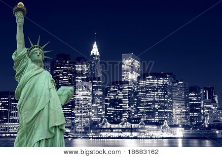 The Statue of Liberty and Manhattan skyline at Night, New York City