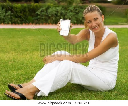 Woman Sit On A Grass