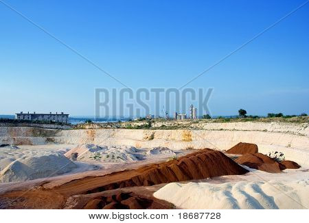 Big stone and sand quarry on a sunny day