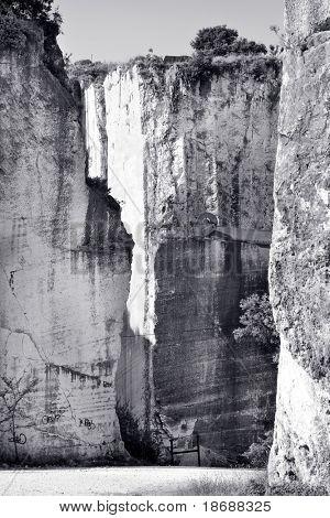 Old abandoned stone quarry - black and white toned photo
