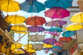 Palette of happiness. Colorful umbrellas background. Colourful umbrellas urban street decoration. Ha poster