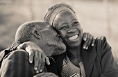in love African American couple in their eighties and seventies, hugging and kissing, Botswana