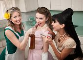 foto of peer-pressure  - Young woman goes along with friends to smoke and drink in a kitchen - JPG