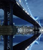 stock photo of new york night  - New York City Skyline and Manhattan Bridge At Night - JPG