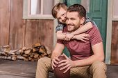 Young Father With Little Son Sitting On Porch At Backyard, Dad And Son Playing poster