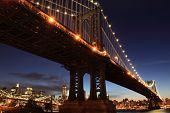 stock photo of new york skyline  - New York City Skyline and Manhattan Bridge At Night - JPG