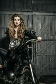 Постер, плакат: Sexy Pretty Biker In Leather Jacket Sitting On Vintage Motorcycle
